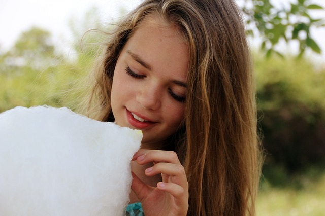 picture of a girl eating candy floss